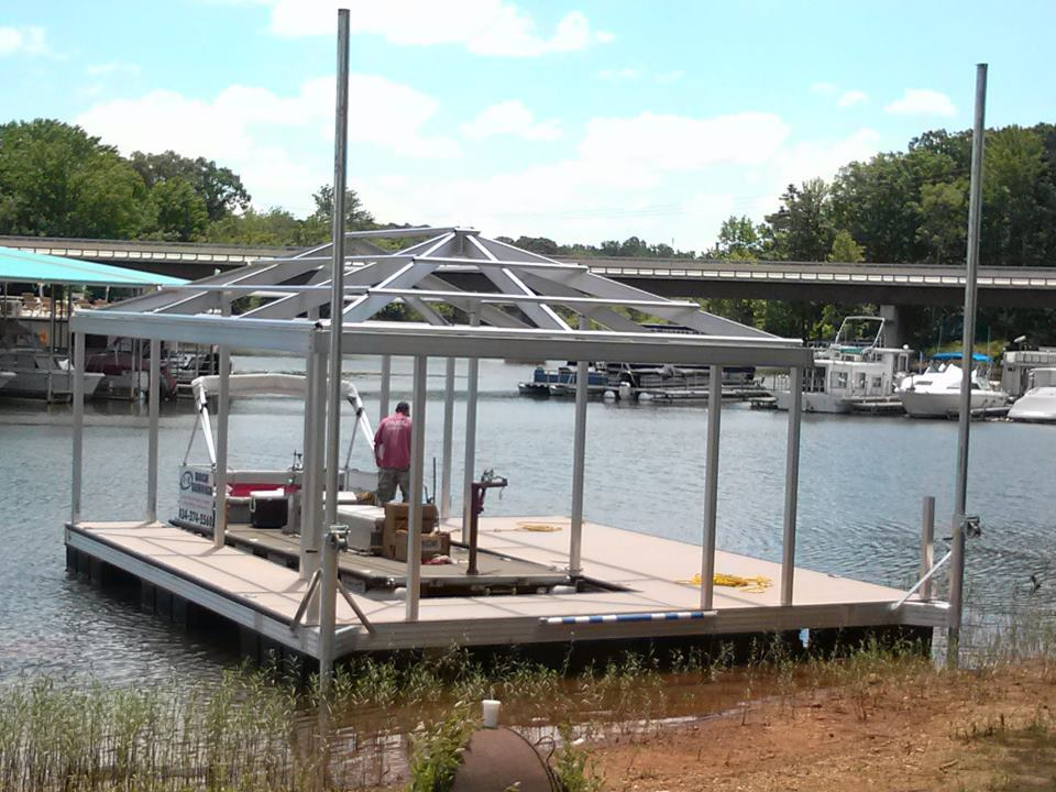 Single slip boat dock with hip roof on Kerr Lake